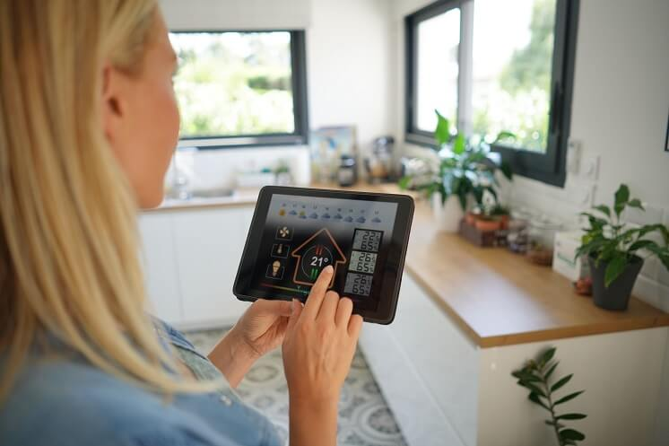 Lady uses smart home device