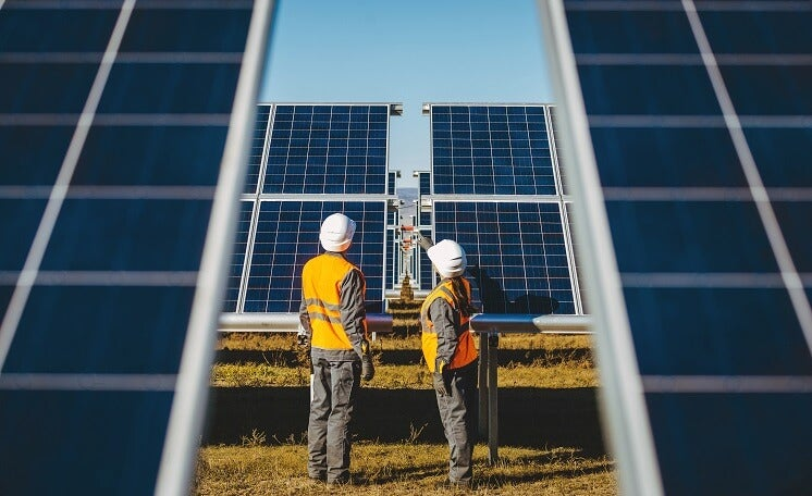 Two workers on solar farm