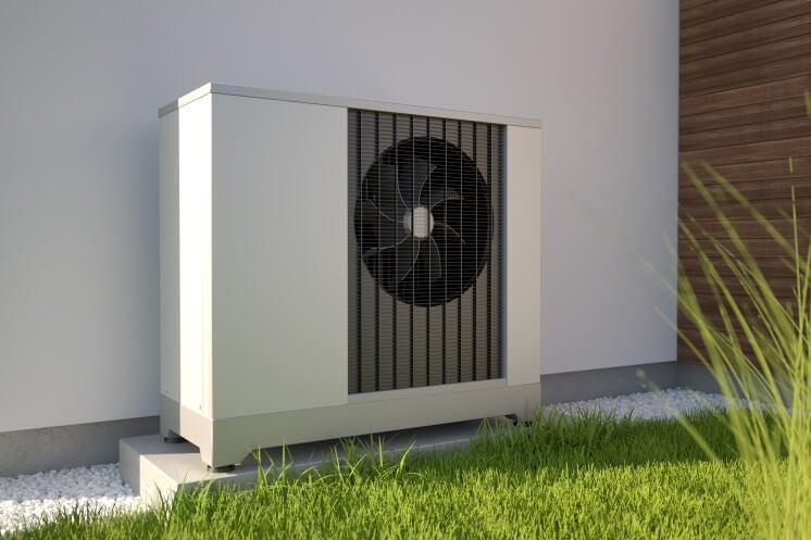 air source heat pump outside a home